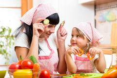 Mom and kid preparing healthy food. Mother and kid girl preparing healthy food royalty free stock photos