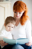 Mom and kid reading book Stock Photography