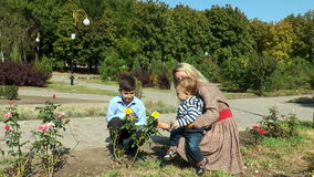 Mom kid shows a yellow rose stock footage