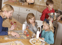 Mom and kids baking Stock Image