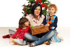 Mom with kids celebrate Christmas Royalty Free Stock Photo