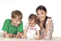 Mom and kids reading Stock Photo