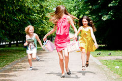 Mom with kids running around in the park Royalty Free Stock Images