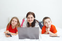 Mom and kids with smartphones Royalty Free Stock Photo