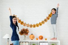 Mom and kids successful hanging up decoration Stock Photos