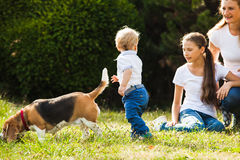 Mom with kids on a walk Royalty Free Stock Image