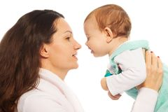 Mom kiss baby Royalty Free Stock Images