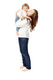 Mom kisses baby. Portrait of Happy cheerful family. Mother and baby kissing, laughing and hugging. Playful mood royalty free stock photo