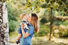 Mother and child son playing stock photography