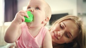 Mom kissing baby. Beautiful mother kissing daughter. Motherhood concept stock footage
