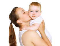 Mom kissing baby Stock Photography