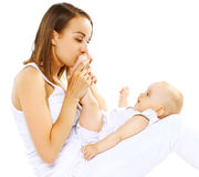 Mom kissing feet baby Royalty Free Stock Image