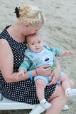 Mom kissing her handsome son - Woman and baby outdoors Royalty Free Stock Images