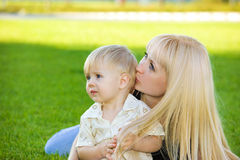 Mom kissing her son. Loving mom kissing her toddler  son Royalty Free Stock Photo