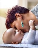 Mom kissing his son. Mom kissing his little son royalty free stock photos