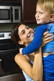 Mom lifting happy child. Stock Images