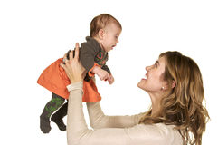 Mom lifting her baby up. Adorable Mother and Child, playing together Stock Photos