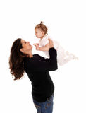 Mom lifting up her baby. Stock Image