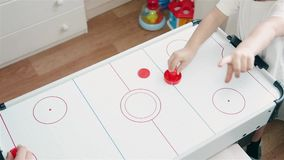 Mom likes to play air hockey with your child 1080p stock footage
