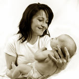 Mom and little baby girl Stock Photos