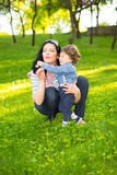 Mom and little boy having fun  in park Stock Photo
