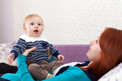 Mom with little   child at home. Stock Photos