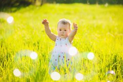 Mom and little daughter cheerfully catching and blowing soap bub Royalty Free Stock Photos