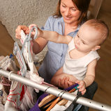 Mom and  little daughter choosing dress Royalty Free Stock Image