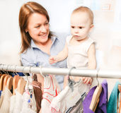Mom and  little daughter choosing dress Royalty Free Stock Photography