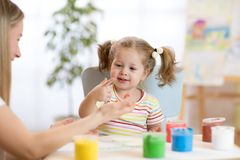Mother and little daughter kid have a fun pastime with finger pints. Mom and little daughter kid have a fun pastime with finger pints Stock Image