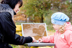 Mom and little daughter with laptop outdoor Stock Photos