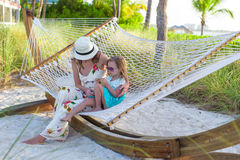 Mom and little girl relaxing in hammock at Royalty Free Stock Photos