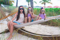 Mom and little girls relaxing in hammock at Stock Images