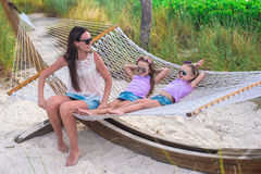 Mom and little girls relaxing in hammock at Stock Photos