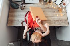 Mom and little son pack a gift royalty free stock photography