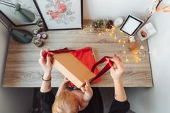 Mom and little son pack a gift stock photo