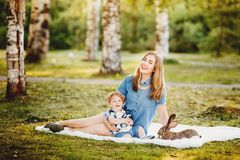 Mom and little son are playing in park stock photos