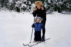 Mom with little son on skis Stock Photography