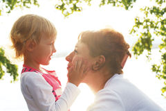 Mom is looking lovingly at her daughter Royalty Free Stock Image