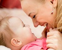 Mom looks with love at baby. Maternity happiness Stock Images