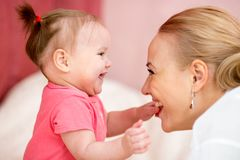 Mom looks with love at baby. Parenthood happiness Royalty Free Stock Photography