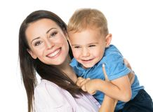 Mom always loves you. Beautiful smimling young mother with her toddler son real family stock photos