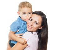 Mom always loves you. Beautiful smimling young mother with her toddler son real family royalty free stock image