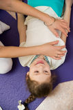 Mom makes daughter massage at the gym Royalty Free Stock Image