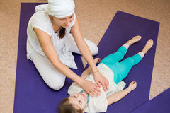 Mom makes daughter massage at the gym royalty free stock photography