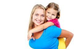 Mom och dotter som har gyckel Fotografering för Bildbyråer