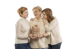 Mom with older daughter embracing and smiling royalty free stock photography