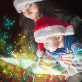 Mom opens the magic box with a gift for child Royalty Free Stock Photo