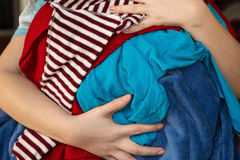 Mom Overloaded With Messy Laundry Royalty Free Stock Image