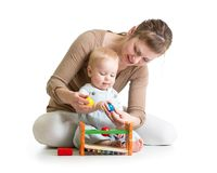 Mom and play musical toy Stock Photo